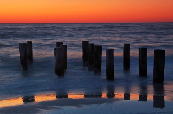 Old Pilings at Sunset Reflected_9912